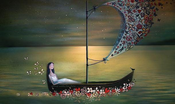 Mujer-sentada-en-una-barca-navegando.jpg