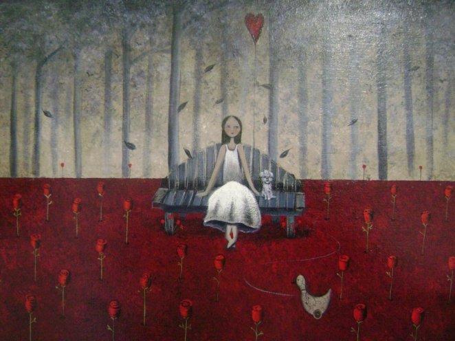 niña-sentada-en-un-sofa-rojo-1024x768.jpg